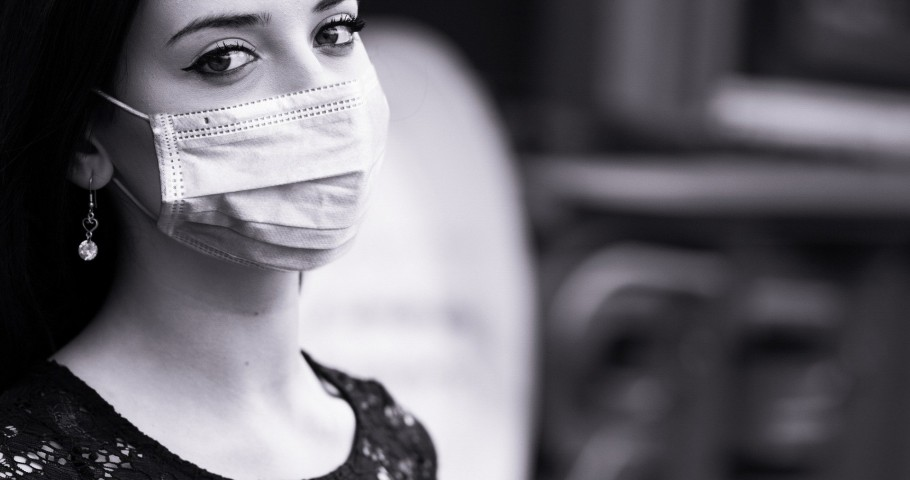 Woman wearing a mask for protection against COVID-19.