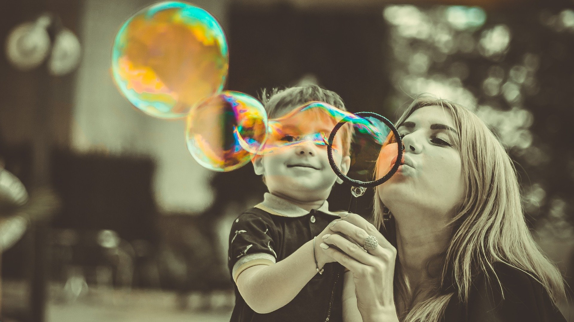 Mother and son play with bubbles.