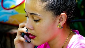 Woman holding a cell phone.