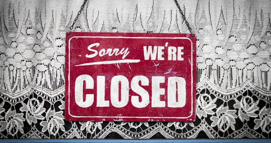 Closed sign in a small business window.